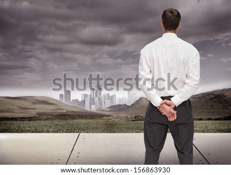 Composite image of businessman turning his back to camera looking at distance city - stock photo