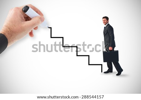 Composite image of businessman walking with his briefcase