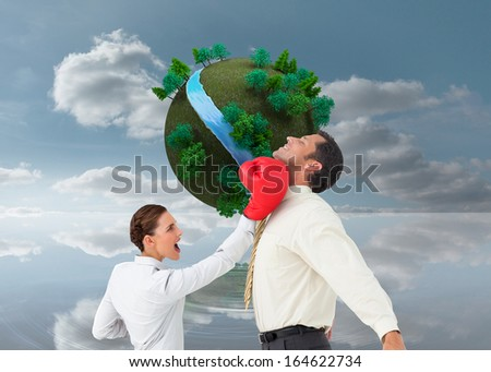Composite image of businesswoman hitting a businessman with boxing gloves - stock photo