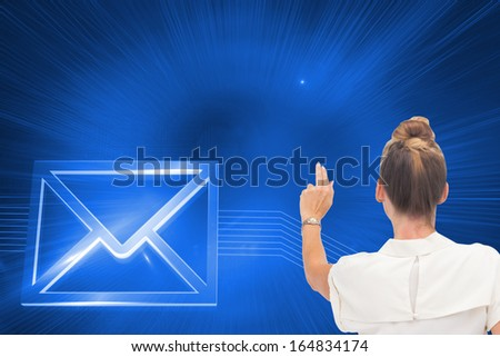 Composite image of businesswoman touching something with hand rear view - stock photo