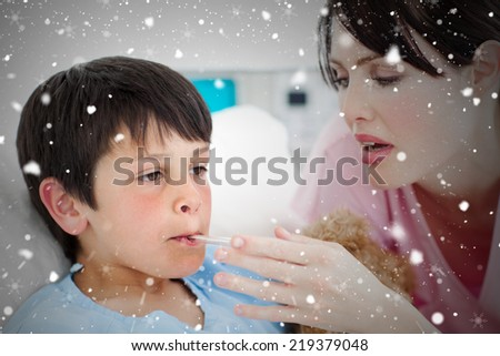 Composite image of caring nurse taking her patients temperature against snow falling - stock photo