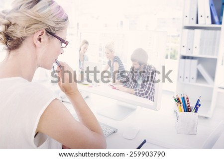 Composite image of casual business people around conference table in office - stock photo