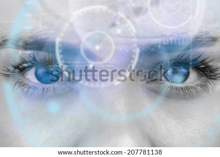 Composite image of close up of female blue eyes against interface - stock photo