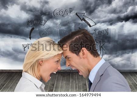 Composite image of colleagues quarreling head against head - stock photo
