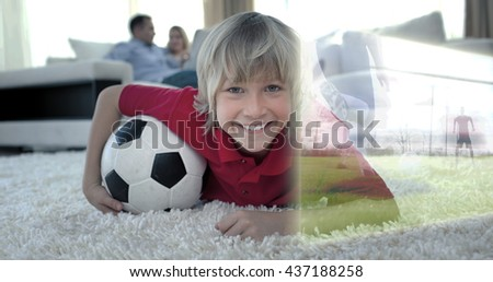 Composite image of cute soccer fan is watching soccer match on television at home - stock photo