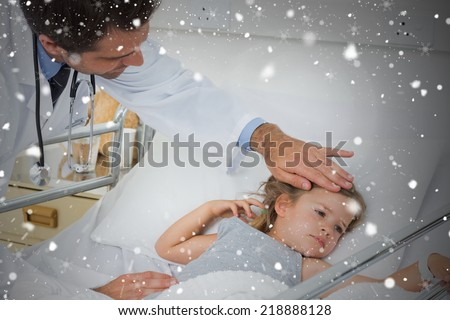 Composite image of doctor checking temperature of sick girl against snow falling - stock photo