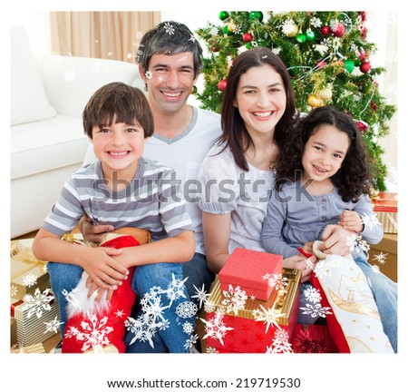 Composite image of family Christmas portrait against snow - stock photo