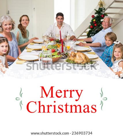 Composite image of family having christmas meal together against border - stock photo