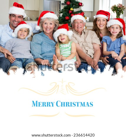 Composite image of family in santa hats celebrating christmas against border - stock photo