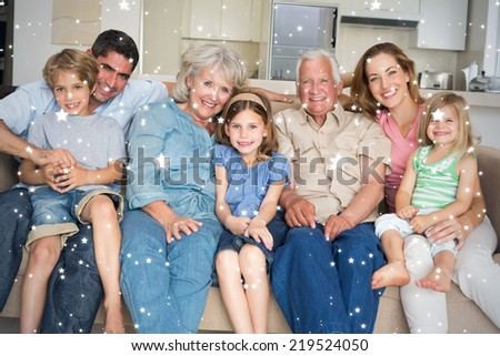 Composite image of Family spending leisure time against snow - stock photo