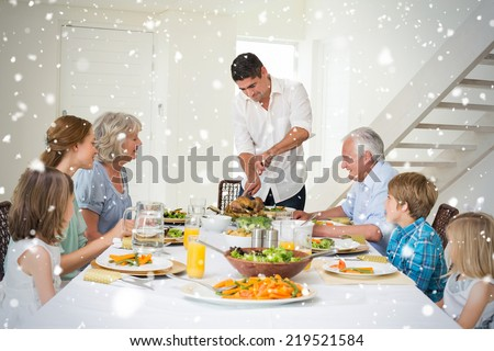 Composite image of Father serving meal to family against snow falling