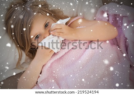 Composite image of girl suffering from cold as she lies in bed against snow falling - stock photo