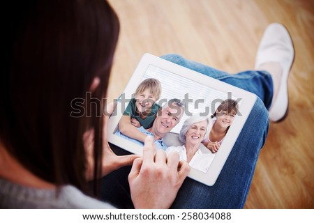 Composite image of grandchildren and grandparents sitting on couch - stock photo
