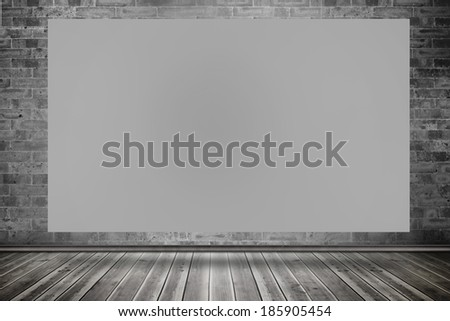 Composite image of grey card against grey room