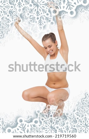Composite image of Happy attractive woman crouching on a scales with snowflakes on silver - stock photo