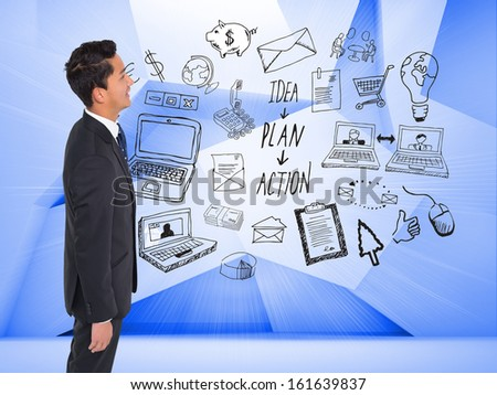 Composite image of happy businessman looking up
