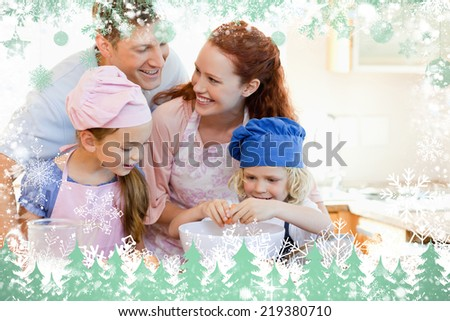 Composite image of happy family enjoys baking together against snow - stock photo