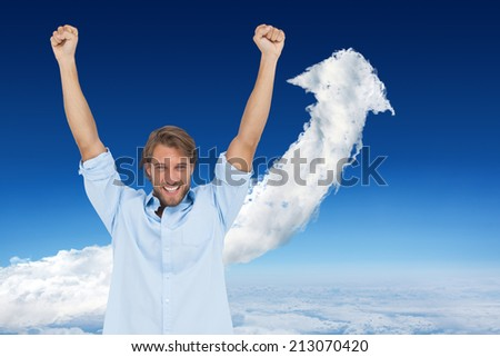 Composite image of happy man celebrating success with arms up against cloud arrow - stock photo