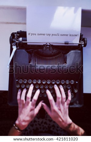 Composite image of if you never try you'll never know,message on a white background against womans hand typing on typewriter - stock photo
