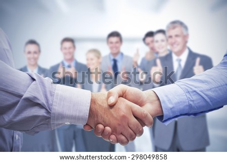 Composite image of men shaking hands