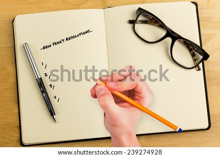 Composite image of new years resolutions against overhead of open notebook with pen and glasses - stock photo