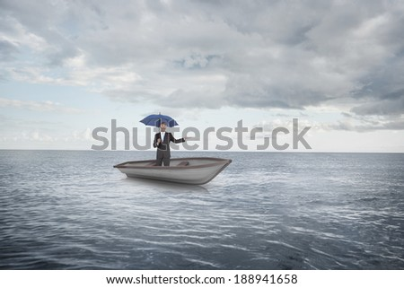 Composite image of peaceful businessman holding blue umbrella in a sailboat against cloudy sky and ocean