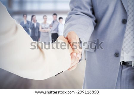 Composite image of people in suit shaking hands - stock photo
