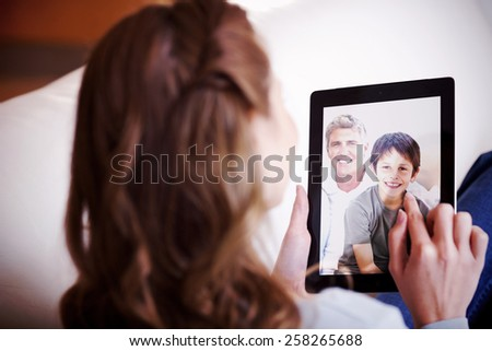 Composite image of portrait of a smiling family - stock photo