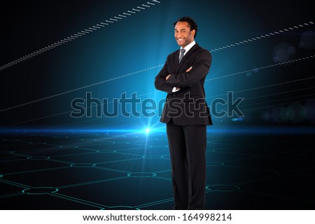 Composite image of portrait of smiling businessman with folded arms