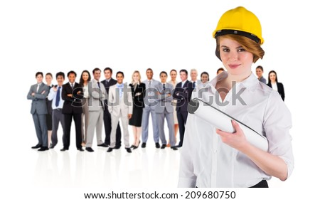 Composite image of pretty young architect smiling at camera against group of workers