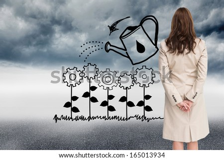 Composite image of rear view of businesswoman looking away - stock photo