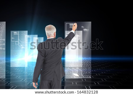 Composite image of rear view of serious businessman standing and writing