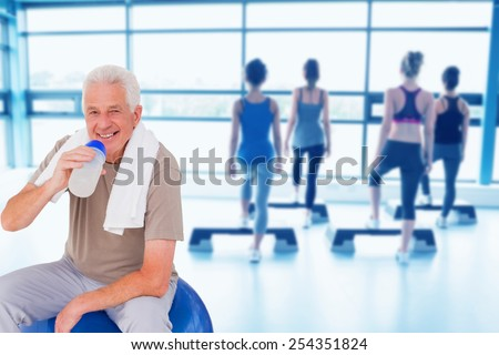 Composite image of senior man drinking from water bottle - stock photo
