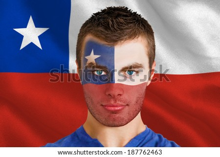 Composite image of serious young chile fan with facepaint against digitally generated chile national flag