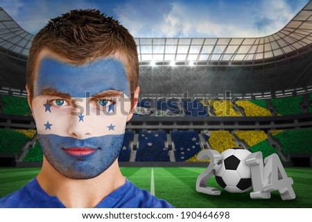 Composite image of serious young honduras fan with face paint against large football stadium - stock photo