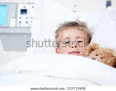 Composite image of Sick adorable little boy lying in a hospital bed with his teddy bear with snow