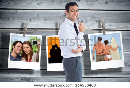 Composite image of smiling businessman holding glasses - stock photo