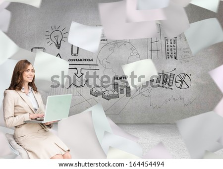 Composite image of smiling businesswoman sitting and using laptop - stock photo