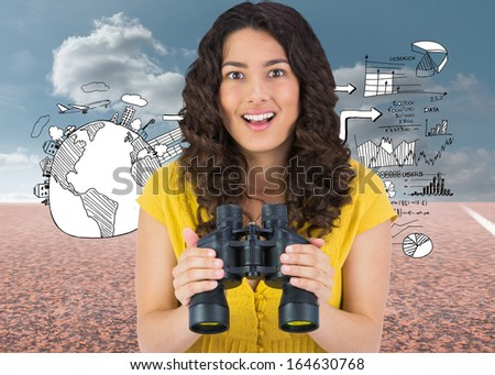 Composite image of smiling casual young woman holding binoculars - stock photo