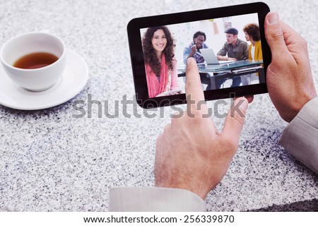 Composite image of smiling designer using tablet - stock photo