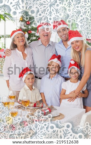 Composite image of smiling family at christmas against snowflakes on silver