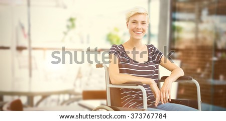 Composite image of smiling woman in a wheelchair - stock photo