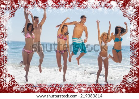 Composite image of snow frame against happy friends jumping on the beach - stock photo