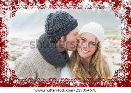 Composite image of snow frame against man kissing a woman on rocky landscape