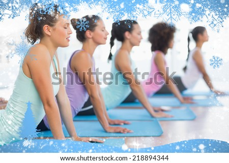Composite image of snow frame against yoga class in gym - stock photo