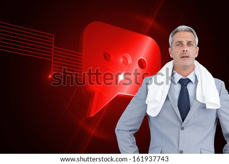 Composite image of sporty businessman with white towel