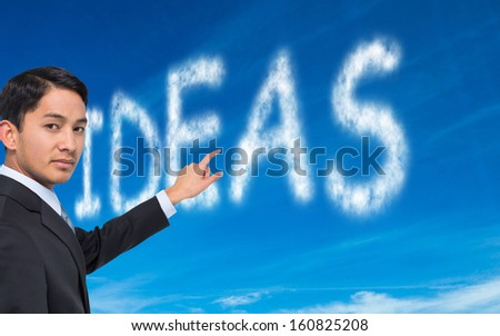 Composite image of stern asian businessman pointing - stock photo