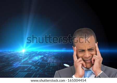 Composite image of stressed businessman putting his fingers on his temples - stock photo