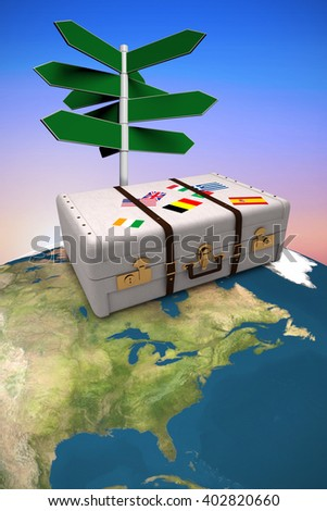 Composite image of suitcase against purple and orange sky - stock photo