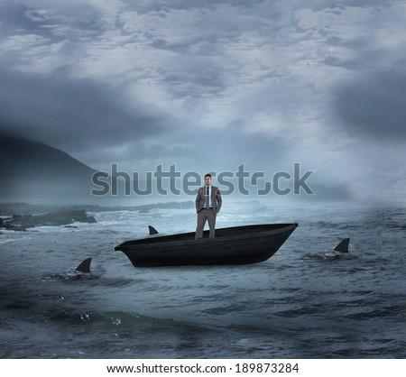 Composite image of thinking businessman in a sailboat being circled by sharks